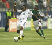 Chris Taylor of the Portland Timbers pursues Gershon Koffie of the Vancouver Whitecaps FC during their MLS game October 21 2012 at BC Place in...