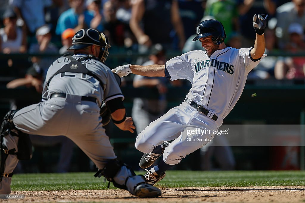 <a gi-track='captionPersonalityLinkClicked' href=/galleries/search?phrase=Chris+Taylor+-+Baseball+Player&family=editorial&specificpeople=13511734 ng-click='$event.stopPropagation()'>Chris Taylor</a> #1 of the Seattle Mariners scores on an RBI single off the bat of Austin Jackson against catcher <a gi-track='captionPersonalityLinkClicked' href=/galleries/search?phrase=Tyler+Flowers&family=editorial&specificpeople=4217244 ng-click='$event.stopPropagation()'>Tyler Flowers</a> #21 of the Chicago White Sox in the seventh inning at Safeco Field on August 10, 2014 in Seattle, Washington.