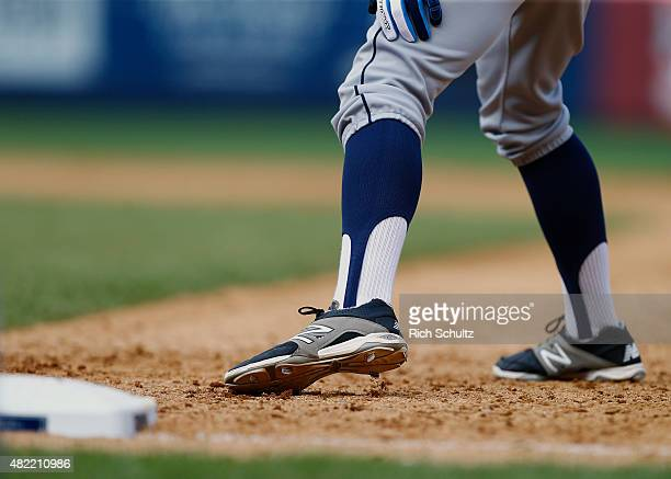 Chris Taylor of the Seattle Mariners wearing high stirrup socks as he takes a lead off first base against the New York Yankees in a MLB baseball game...