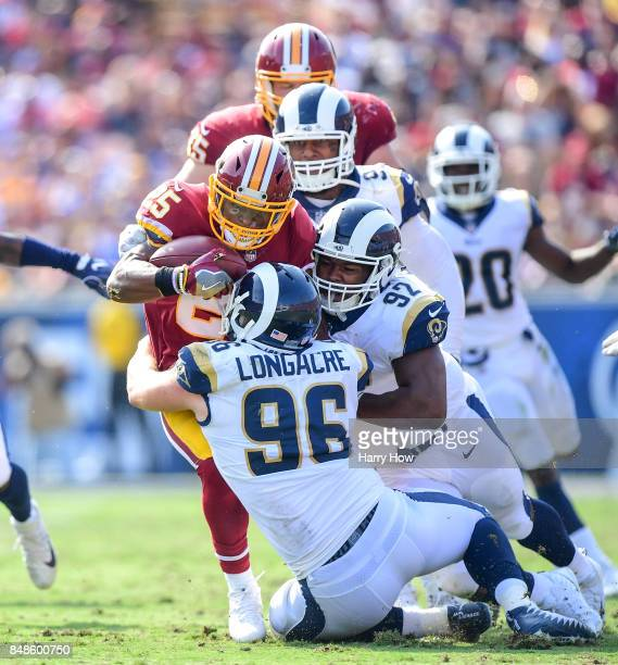 Chris Thompson of the Washington Redskins is brought down by Matt Longacre Tanzel Smart and Ethan Westbrooks of the Los Angeles Rams during the third...