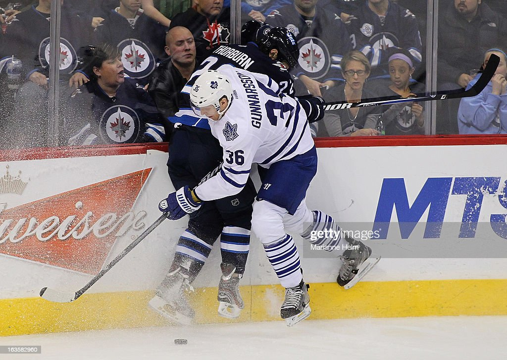 <a gi-track='captionPersonalityLinkClicked' href=/galleries/search?phrase=Chris+Thorburn&family=editorial&specificpeople=2222066 ng-click='$event.stopPropagation()'>Chris Thorburn</a> #22 of the Winnipeg Jets and <a gi-track='captionPersonalityLinkClicked' href=/galleries/search?phrase=Carl+Gunnarsson&family=editorial&specificpeople=5557315 ng-click='$event.stopPropagation()'>Carl Gunnarsson</a> #36 of the Toronto Maple Leafs fight for the puck during third period action on March 12, 2013 at the MTS Centre in Winnipeg, Manitoba, Canada.