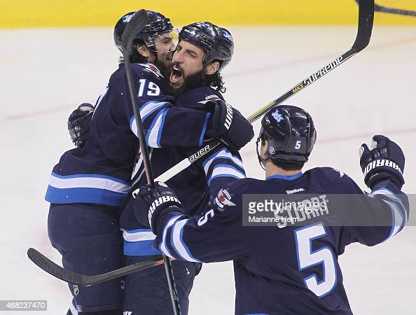 Chris Thorburn of the Winnipeg Jets congratulates teammate Jim Slater for his goal in first period action in an NHL game against the New York Rangers...