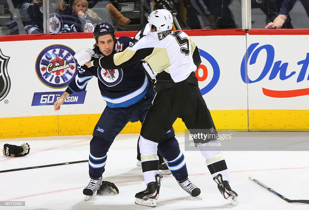 Chris Thorburn #22 of the Winnipeg Jets engages in a first period fight with Deryk Engelland #5 of the Pittsburgh Penguins at the MTS Centre on February 15, 2013 in Winnipeg, Manitoba, Canada.
