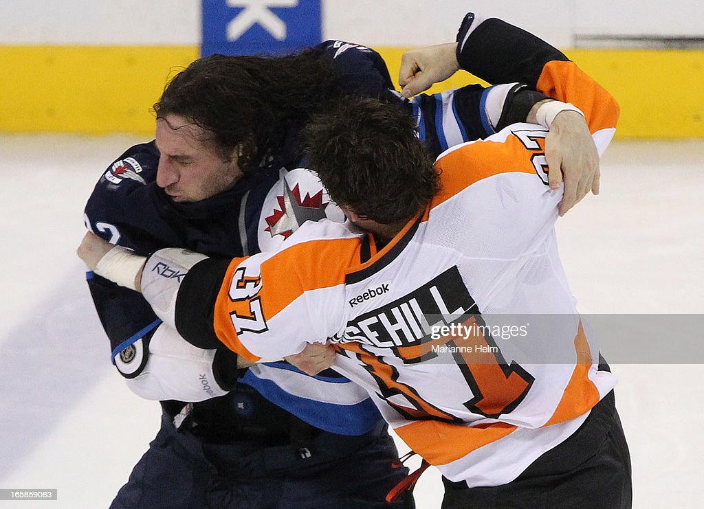 <a gi-track='captionPersonalityLinkClicked' href=/galleries/search?phrase=Chris+Thorburn&family=editorial&specificpeople=2222066 ng-click='$event.stopPropagation()'>Chris Thorburn</a> #22 of the Winnipeg Jets fights with Jay Rosehill #37 of the Philadelphia Flyers during third period in a game between the Winnipeg Jets and the Philadelphia Flyers on April 6, 2013 at the MTS Centre in Winnipeg, Manitoba, Canada.