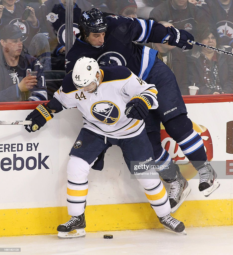 Chris Thorburn #22 of the Winnipeg Jets is lifted off the ice by Andrej Sekera #44 of the Buffalo Sabres in third-period action on April 9, 2013 at the MTS Centre in Winnipeg, Manitoba, Canada.