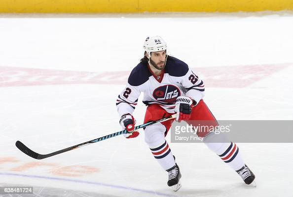Chris Thorburn of the Winnipeg Jets keeps an eye on the play during second period action against the Calgary Flames at the MTS Centre on January 9...