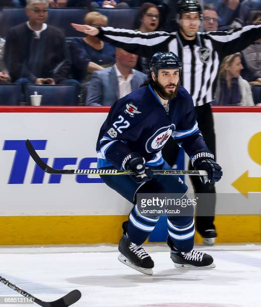 Chris Thorburn of the Winnipeg Jets keeps an eye on the play during third period action against the Nashville Predators at the MTS Centre on April 8...