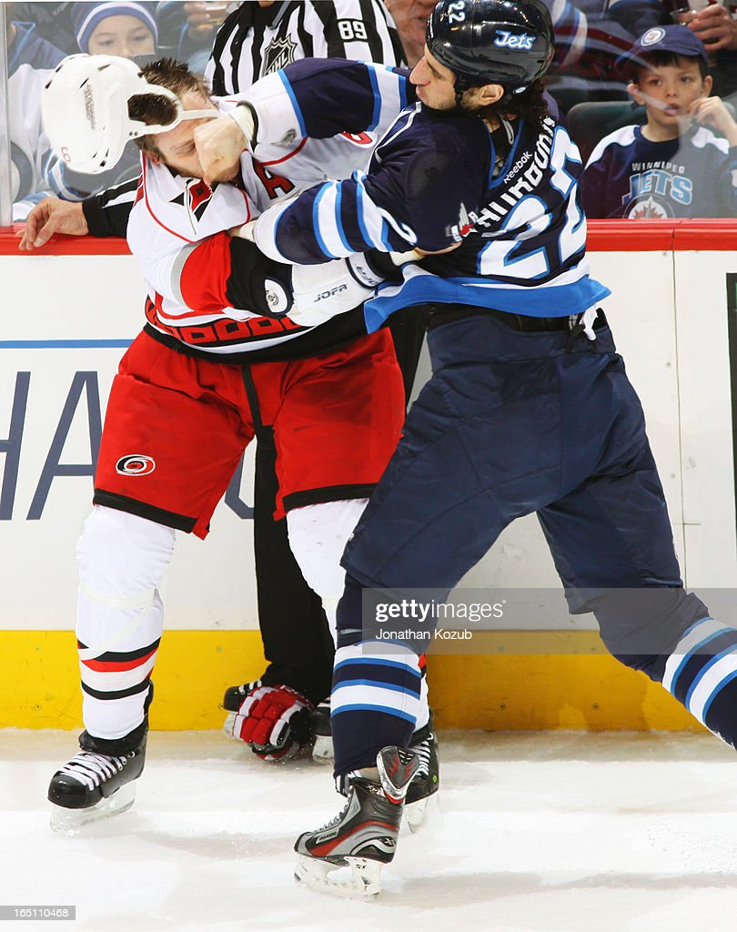 <a gi-track='captionPersonalityLinkClicked' href=/galleries/search?phrase=Chris+Thorburn&family=editorial&specificpeople=2222066 ng-click='$event.stopPropagation()'>Chris Thorburn</a> #22 of the Winnipeg Jets lands a punch to the head of <a gi-track='captionPersonalityLinkClicked' href=/galleries/search?phrase=Tim+Gleason&family=editorial&specificpeople=211575 ng-click='$event.stopPropagation()'>Tim Gleason</a> #6 of the Carolina Hurricanes during a first period fight at the MTS Centre on March 30, 2013 in Winnipeg, Manitoba, Canada.