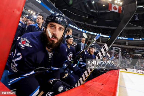 Chris Thorburn of the Winnipeg Jets looks on from the bench during third period action against the Nashville Predators at the MTS Centre on April 8...