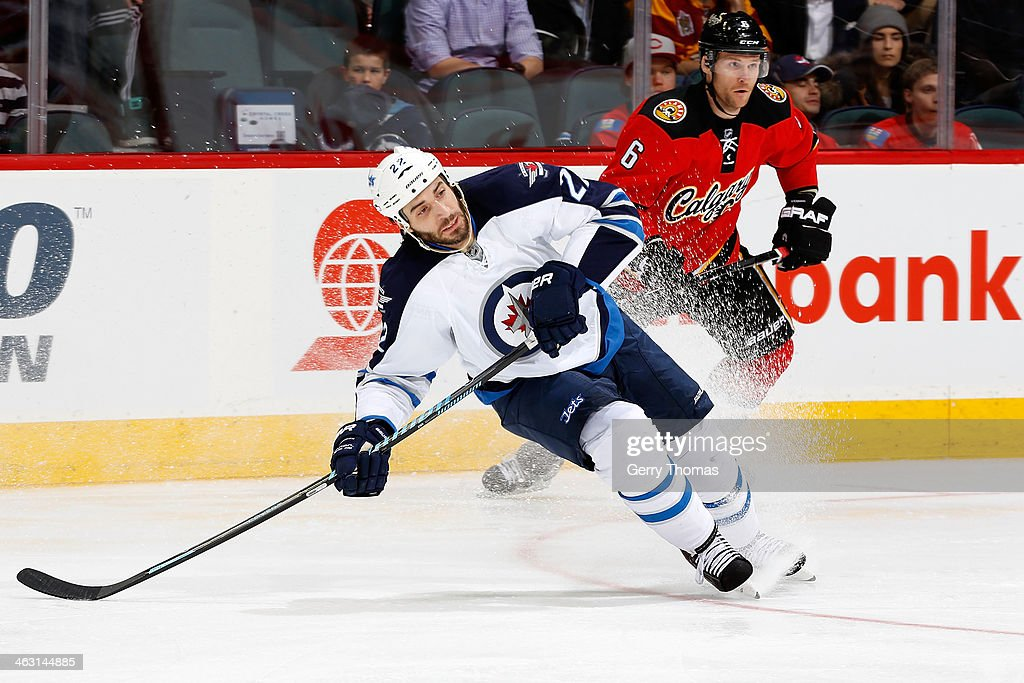 <a gi-track='captionPersonalityLinkClicked' href=/galleries/search?phrase=Chris+Thorburn&family=editorial&specificpeople=2222066 ng-click='$event.stopPropagation()'>Chris Thorburn</a> #22 of the Winnipeg Jets skates against <a gi-track='captionPersonalityLinkClicked' href=/galleries/search?phrase=Dennis+Wideman&family=editorial&specificpeople=575234 ng-click='$event.stopPropagation()'>Dennis Wideman</a> #6 of the Calgary Flames at Scotiabank Saddledome on January 16, 2013 in Calgary, Alberta, Canada.
