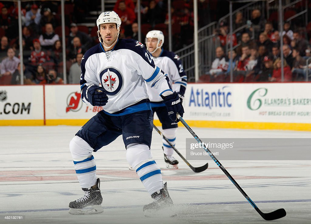 <a gi-track='captionPersonalityLinkClicked' href=/galleries/search?phrase=Chris+Thorburn&family=editorial&specificpeople=2222066 ng-click='$event.stopPropagation()'>Chris Thorburn</a> #22 of the Winnipeg Jets skates against the New Jersey Devils at the Prudential Center on November 25, 2013 in Newark, New Jersey. The Jets defeated the Devils 3-1.