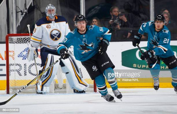 Chris Tierney and Timo Meier of the San Jose Sharks skate as Robin Lehner of the Buffalo Sabres looks at SAP Center on October 12 2017 in San Jose...