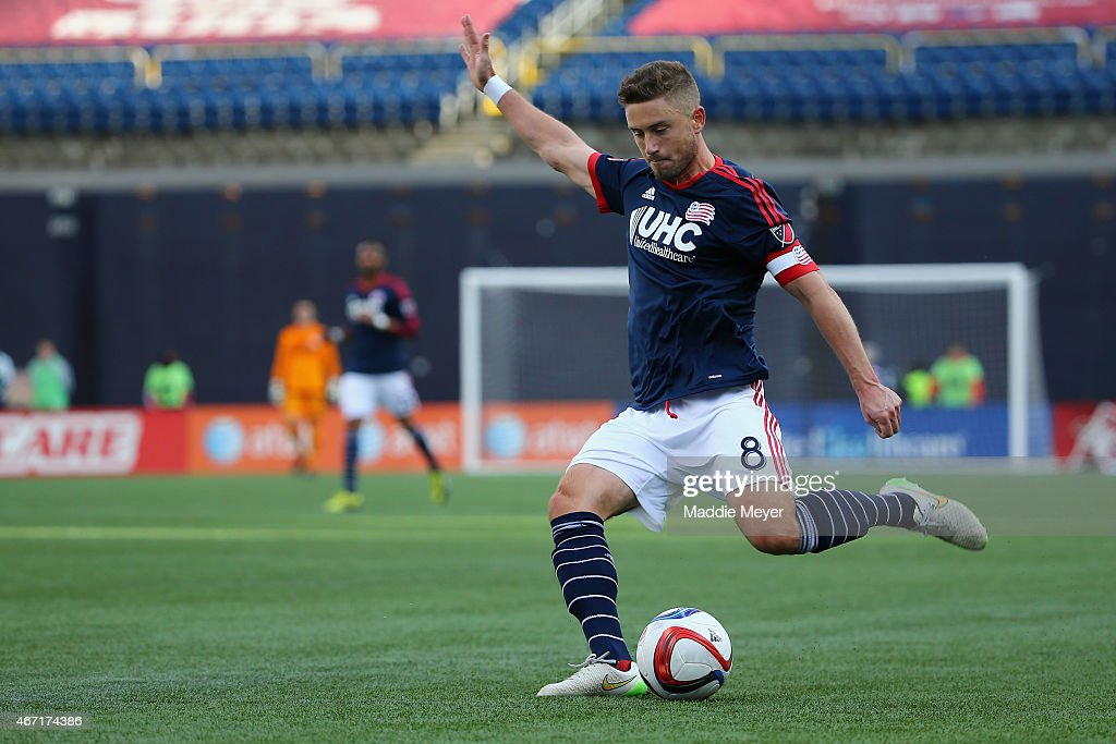 Chris Tierney of New England Revolution crosses the ball into the box against the Montreal Impact during the second half at Gillette Stadium on March...