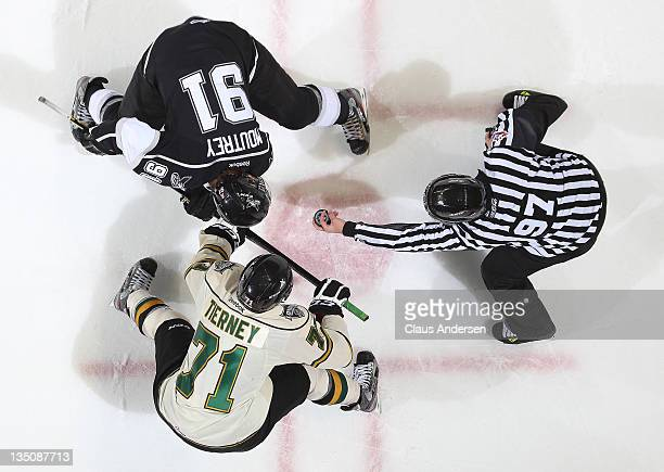 Chris Tierney of the London Knights gets set to take a faceoff against Nick Moutrey of the Saginaw Spirit in a game on December 2 2011 at the John...