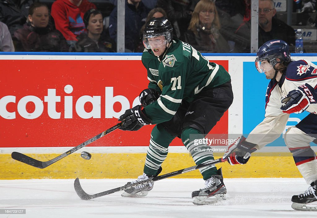 Chris Tierney #71 of the London Knights tries to corral a puck in a first round playoff game against the Saginaw Spirit on March 24, 2013 at the Budweiser Gardens in London, Ontario, Canada. The Knights defeated the Spirit 3-2 in double overtime to take a 2-0 series lead.