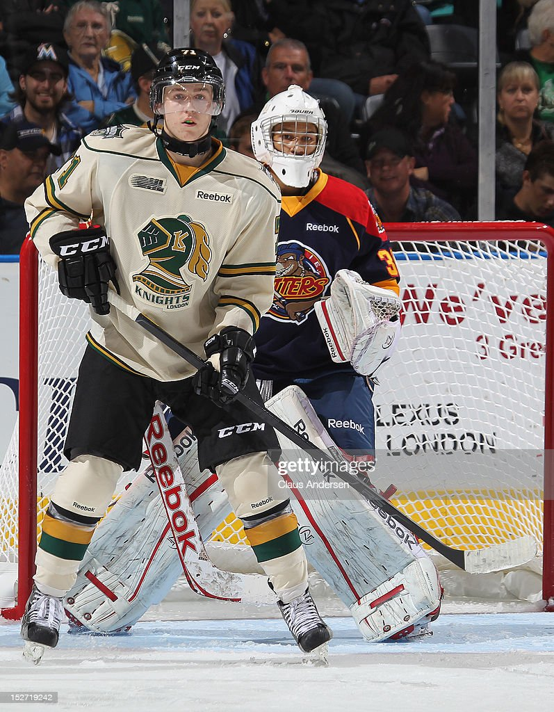 Chris Tierney #71 of the London Knights waits for a shot to tip in front of <a gi-track='captionPersonalityLinkClicked' href=/galleries/search?phrase=Oscar+Dansk&family=editorial&specificpeople=8613152 ng-click='$event.stopPropagation()'>Oscar Dansk</a> #38 of the Erie Otters in an OHL game on September 21, 2012 at the Budweiser Gardens in London, Canada. The Knights defeated the Otters 8-2.