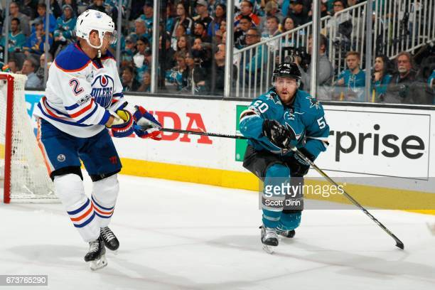 Chris Tierney of the San Jose Sharks and Andrej Sekera of the Edmonton Oilers battle in Game Six of the Western Conference First Round during the...
