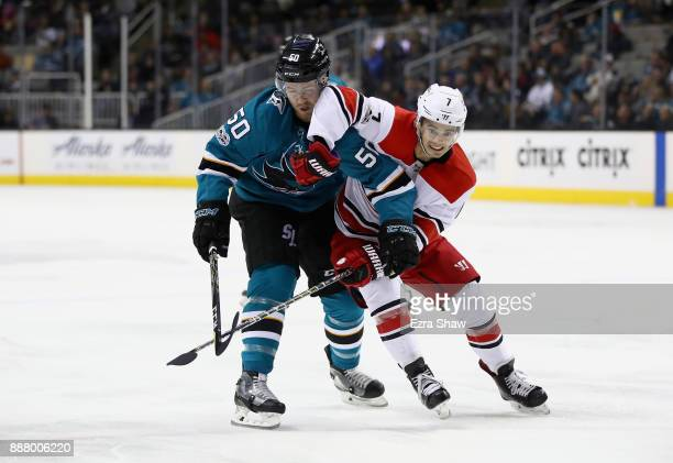 Chris Tierney of the San Jose Sharks and Derek Ryan of the Carolina Hurricanes get tangled up during their game at SAP Center on December 7 2017 in...