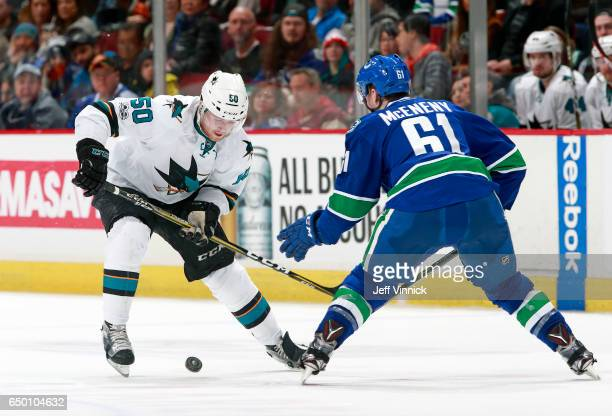 Chris Tierney of the San Jose Sharks and Evan McEneny of the Vancouver Canucks watch a loose puck during their NHL game at Rogers Arena February 25...
