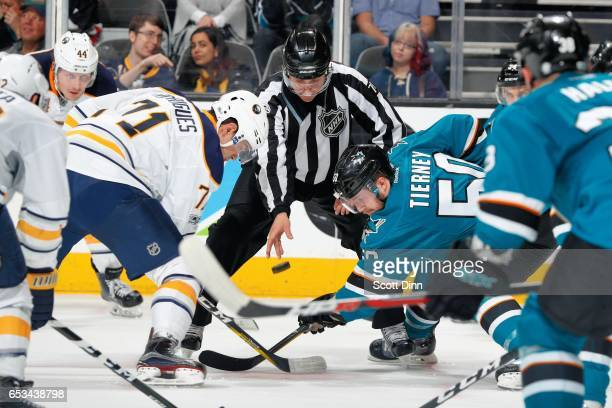 Chris Tierney of the San Jose Sharks and Evan Rodrigues of the Buffalo Sabres face off during a NHL game at SAP Center at San Jose on March 14 2017...