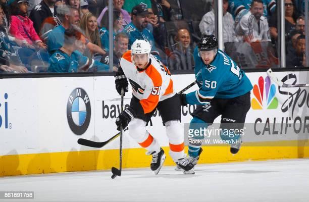 Chris Tierney of the San Jose Sharks and Valtteri Filppula of the Philadelphia Flyers skate along the boards at SAP Center at San Jose on October 4...