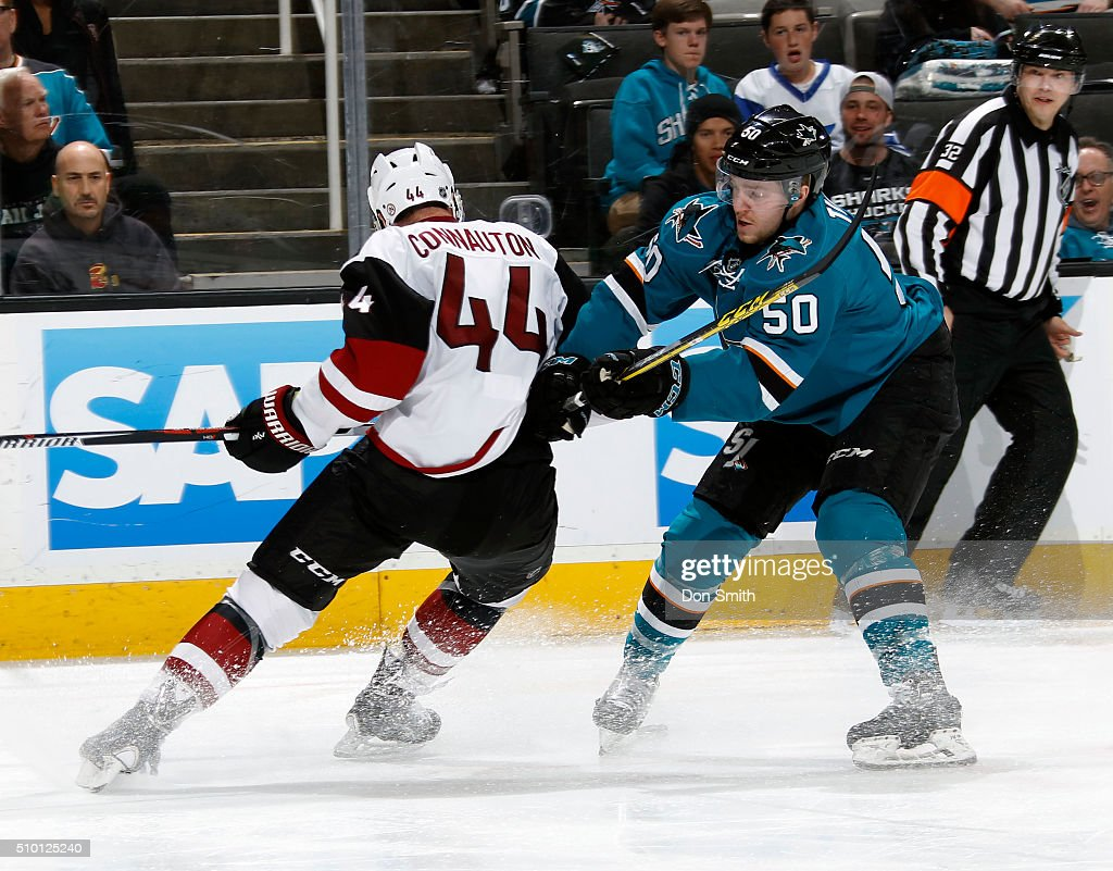 Chris Tierney #50 of the San Jose Sharks checks Kevin Connauton #44 of the Arizona Coyotes during a NHL game at the SAP Center at San Jose on February 13, 2016 in San Jose, California.