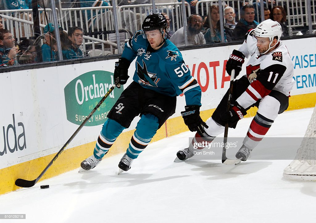 Chris Tierney #50 of the San Jose Sharks defends the puck against Martin Hanzal #11 of the Arizona Coyotes during a NHL game at the SAP Center at San Jose on February 13, 2016 in San Jose, California.