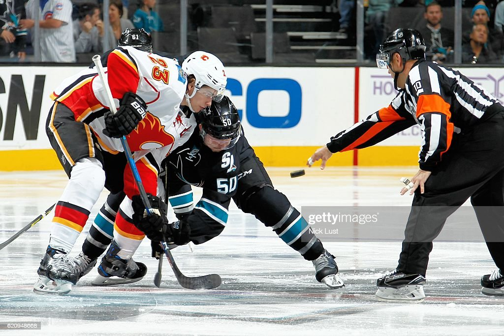 Chris Tierney #50 of the San Jose Sharks faces off against Sean Monahan #23 of the Calgary Flames during a NHL game at SAP Center at San Jose on November 3, 2016 in San Jose, California.