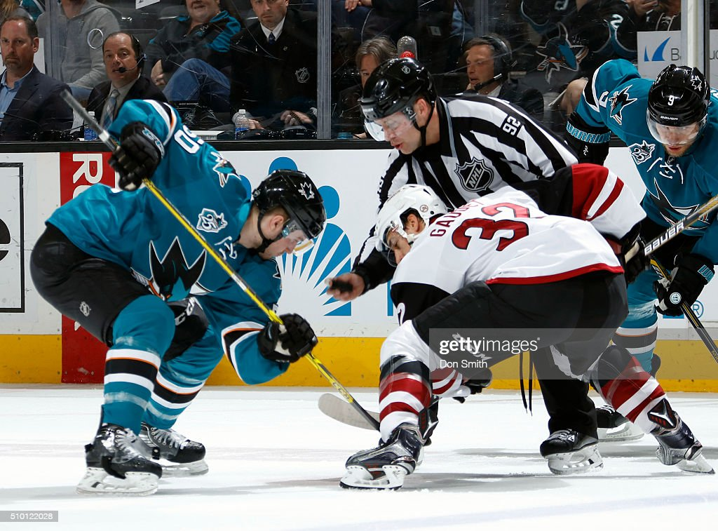 Chris Tierney #50 of the San Jose Sharks faces off against Tyler Gaudet #32 of the Arizona Coyotes during a NHL game at the SAP Center at San Jose on February 13, 2016 in San Jose, California.