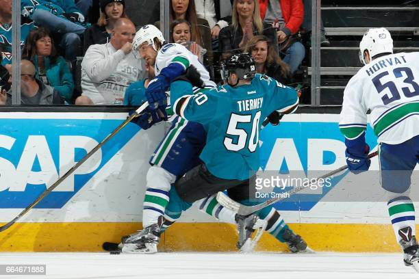 Chris Tierney of the San Jose Sharks hits a Vancouver Canuck during a NHL game at SAP Center at San Jose on April 4 2017 in San Jose California