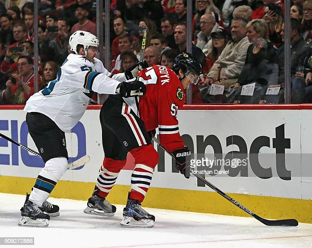 Chris Tierney of the San Jose Sharks pressures Trevor van Riemsdyk of the Chicago Blackhawks at the United Center on February 9 2016 in Chicago...