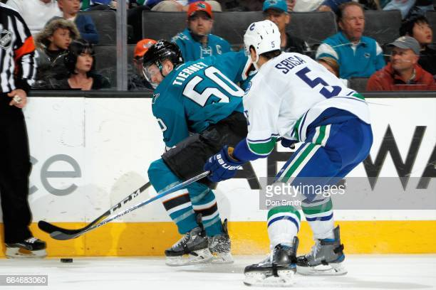 Chris Tierney of the San Jose Sharks skates against Luca Sbisa of the Vancouver Canucks during a NHL game at SAP Center at San Jose on April 4 2017...
