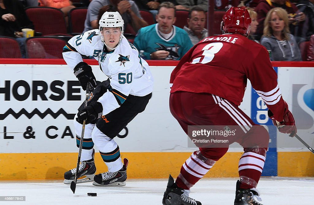 Chris Tierney #50 of the San Jose Sharks skates with the puck against Keith Yandle #3 of the Arizona Coyotes during the preseason NHL game at Gila River Arena on October 3, 2014 in Glendale, Arizona. The Sharks defeated the Coyotes 3-1.