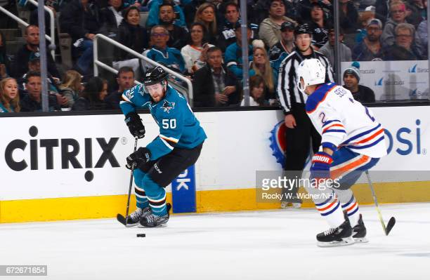 Chris Tierney of the San Jose Sharks skates with the puck against Andrej Sekera of the Edmonton Oilers in Game Six of the Western Conference First...