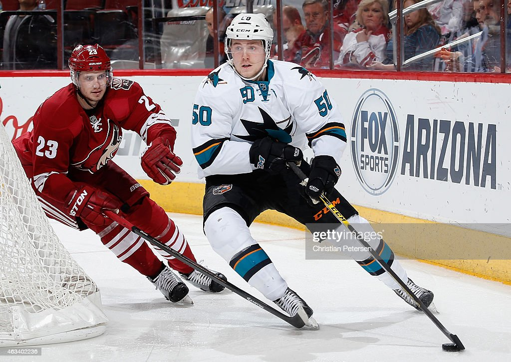Chris Tierney #50 of the San Jose Sharks skates with the puck ahead of Oliver Ekman-Larsson #23 of the Arizona Coyotes during the third period of the NHL game at Gila River Arena on February 13, 2015 in Glendale, Arizona. The Sharks defeated the Coyotes 4-2.