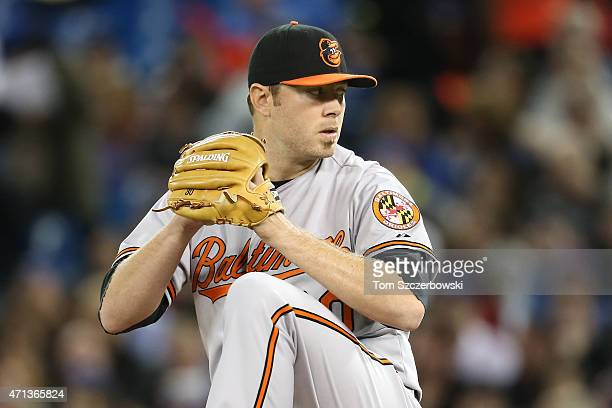 Chris Tillman of the Baltimore Orioles delivers a pitch during MLB game action against the Toronto Blue Jays on April 23 2015 at Rogers Centre in...