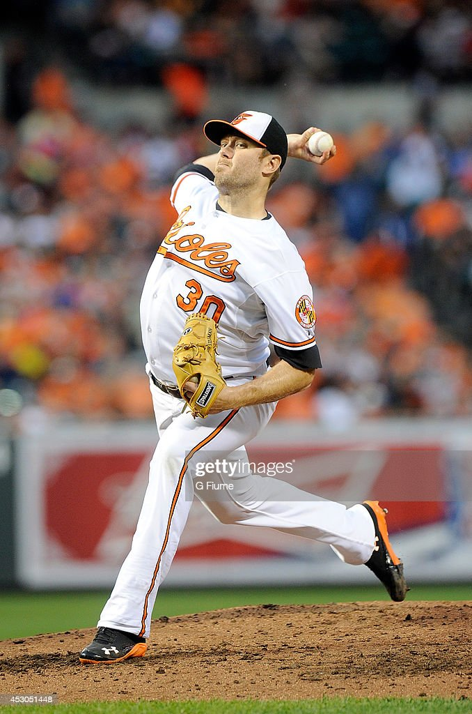 <a gi-track='captionPersonalityLinkClicked' href=/galleries/search?phrase=Chris+Tillman&family=editorial&specificpeople=713179 ng-click='$event.stopPropagation()'>Chris Tillman</a> #30 of the Baltimore Orioles pitches against the Los Angeles Angels of Anaheim at Oriole Park at Camden Yards on July 29, 2014 in Baltimore, Maryland.