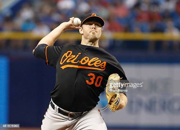 Chris Tillman of the Baltimore Orioles pitches during the first inning of a game against the Tampa Bay Rays on July 24 2015 at Tropicana Field in St...