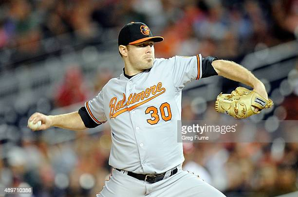 Chris Tillman of the Baltimore Orioles pitches in the first inning against the Washington Nationals at Nationals Park on September 23 2015 in...