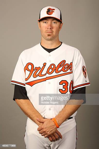 Chris Tillman of the Baltimore Orioles poses during Photo Day on Sunday March 1 2015 at Ed Smith Stadium in Sarasota Florida