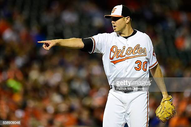 Chris Tillman of the Baltimore Orioles reacts after a pitch in the seventh inning during a MLB baseball game against the Kansas City Royals at Oriole...