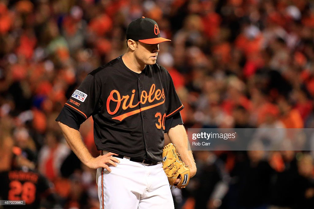 <a gi-track='captionPersonalityLinkClicked' href=/galleries/search?phrase=Chris+Tillman&family=editorial&specificpeople=713179 ng-click='$event.stopPropagation()'>Chris Tillman</a> #30 of the Baltimore Orioles reacts after giving up a home run to Alcides Escobar #2 of the Kansas City Royals in the third inning during Game One of the American League Championship Series at Oriole Park at Camden Yards on October 10, 2014 in Baltimore, Maryland.