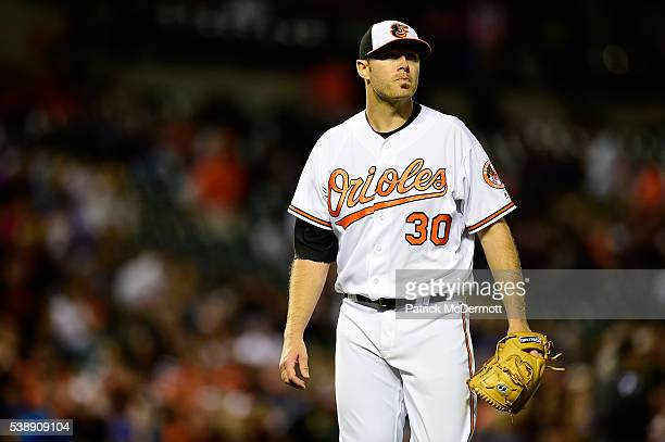 Chris Tillman of the Baltimore Orioles reacts after striking out Cheslor Cuthbert of the Kansas City Royals to end the top of the seventh inning...
