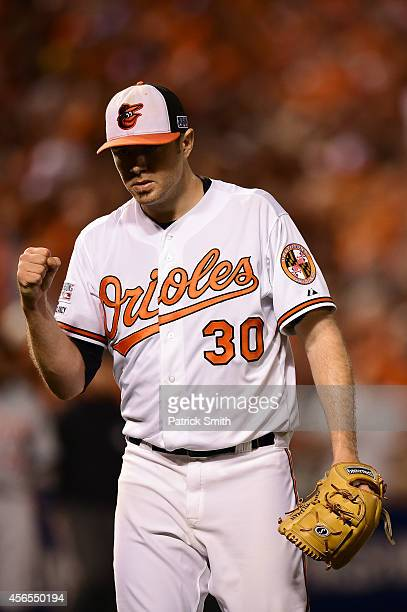 Chris Tillman of the Baltimore Orioles reacts after the fifth inning against the Detroit Tigers during Game One of the American League Division...