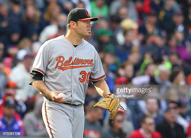 Chris Tillman of the Baltimore Orioles reacts in the third inning against the Boston Red Sox at Fenway Park April 18 2015 in Boston Massachusetts