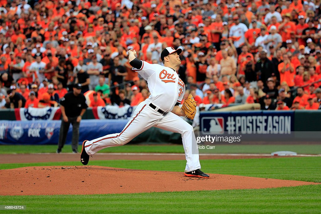 <a gi-track='captionPersonalityLinkClicked' href=/galleries/search?phrase=Chris+Tillman&family=editorial&specificpeople=713179 ng-click='$event.stopPropagation()'>Chris Tillman</a> #30 of the Baltimore Orioles throws a pitch in the first inning against against the Detroit Tigers during Game One of the American League Division Series at Oriole Park at Camden Yards on October 2, 2014 in Baltimore, Maryland.