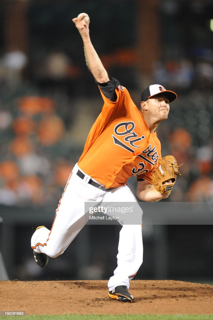 Chris Tilman #30 of the Baltimore Orioles pitches during a baseball game against the Kansas City Royals on August 11, 2012 at Oriole Park at Camden Yards in Baltimore, Maryland.