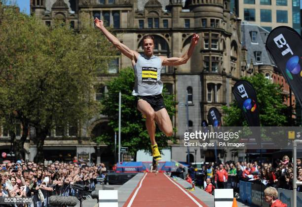 Chris Tomlinson competes in the mens long jump during the BT Great City Games in Manchester