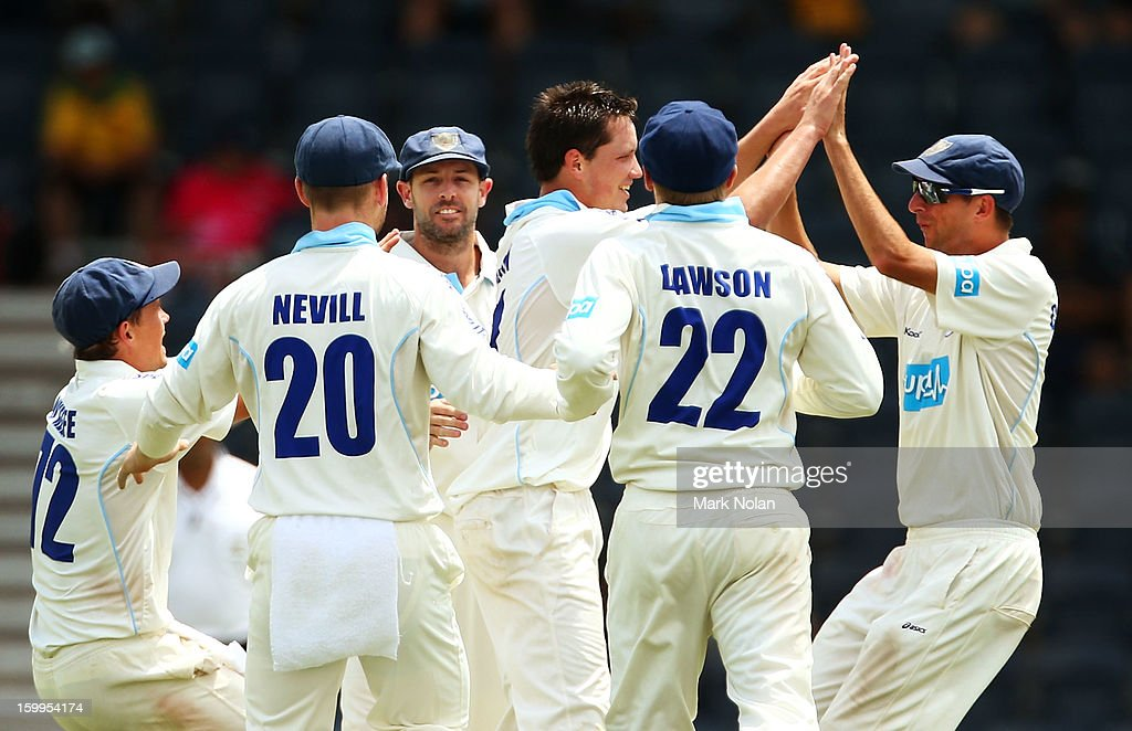 Chris Tremain of the Blues is congratulated after taking the wicket of Michael Hussey of the Warriors during day one of the Sheffield Shield match between the New South Wales Blues and the Western Australia Warriors at Blacktown International Sportspark on January 24, 2013 in Sydney, Australia.