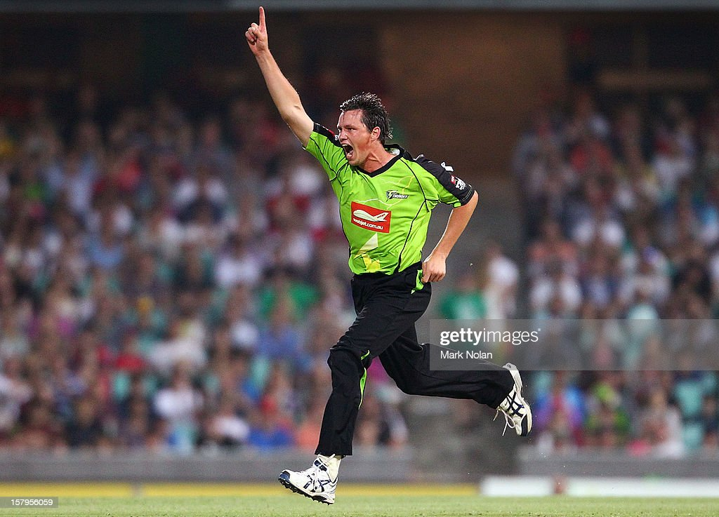 Chris Tremain of the Thunder celebrates getting the wicket of David Warner of the Sixers during the Big Bash League match between the Sydney Sixers and the Sydney Thunder at Sydney Cricket Ground on December 8, 2012 in Sydney, Australia.